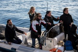 Italian Members of Parliament Stefania Prestigiacomo (C), Nicola Fratoianni (C-R), Riccardo Magi (Rear R) and the major of Syracuse, Francesco Italia (L) arrive aboard a dinghy to board the Dutch-flagged rescue vessel Sea Watch 3, to meet with 47 migrants and verify the situation onboard, on January 27, 2019 off Syracuse, Sicily. - Members of parliament who had been refused permission by the ministry to board the Sea Watch 3 made their own way onto the vessel which has taken shelter from bad weather off the coast of Sicily. Italy's interior minister Matteo Salvini said on January 27 he was gathering legal evidence against the crew of the Dutch-flagged rescue ship as calls grew for 47 migrants to be allowed to land. (Photo by FEDERICO SCOPPA / AFP)