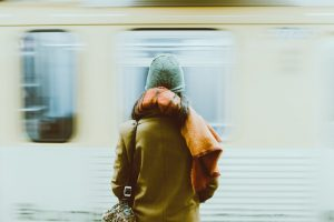 time-lapse-photography-of-person-standing-near-train-2120010