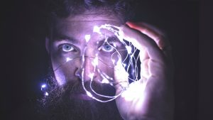 person-holding-string-lights-photo-818563
