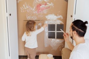 photo-of-child-painting-cardboard-3933253