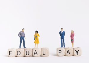 business-man-woman-sitting-wooden-cubes-with-equal-pay-written