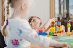 toddler-playing-with-toy-constructor