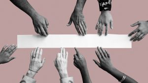 Diverse hands touching white paper mockup pink wallpaper