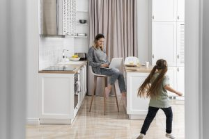 woman-working-home-with-kid